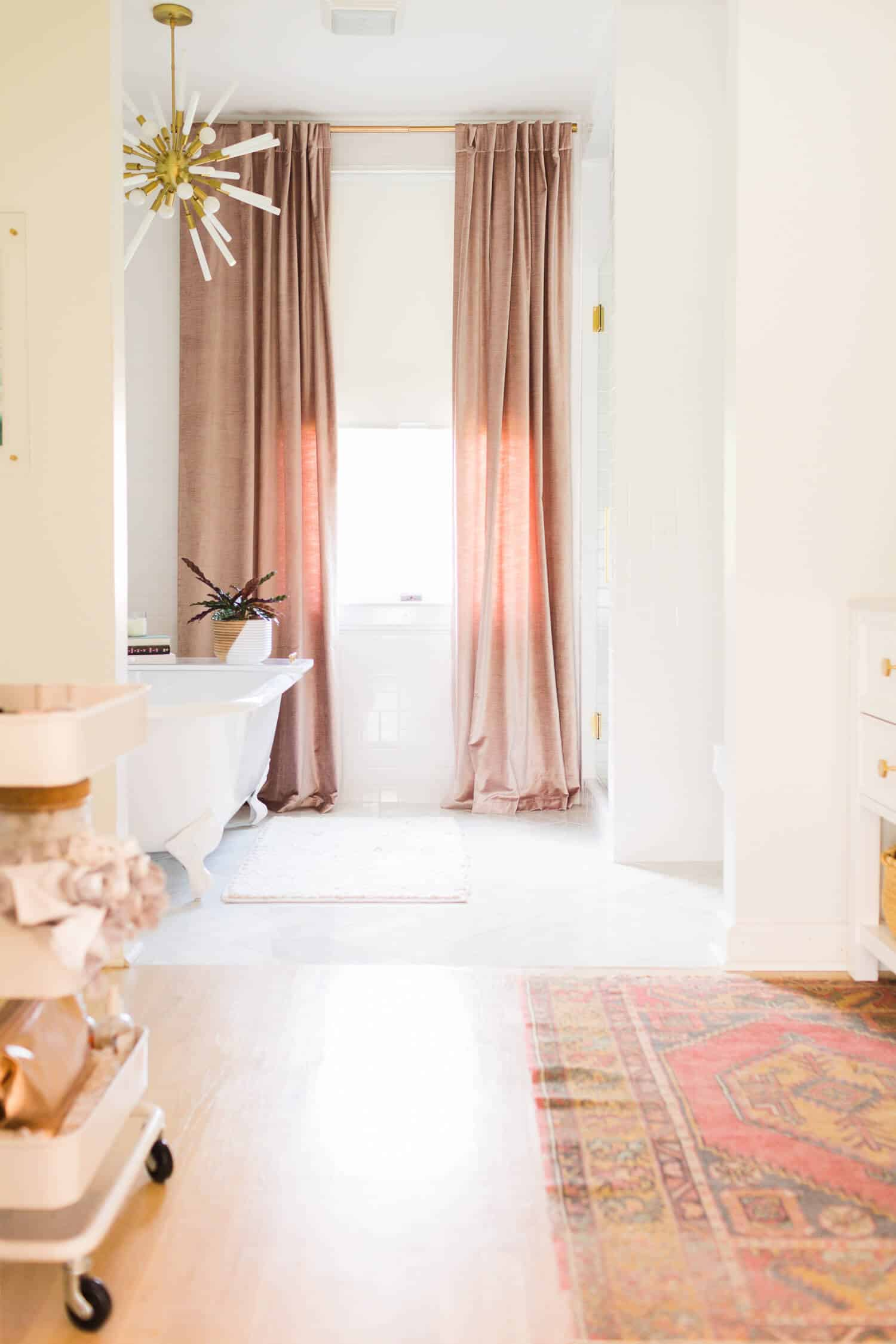 bathroom with floor to ceiling curtains