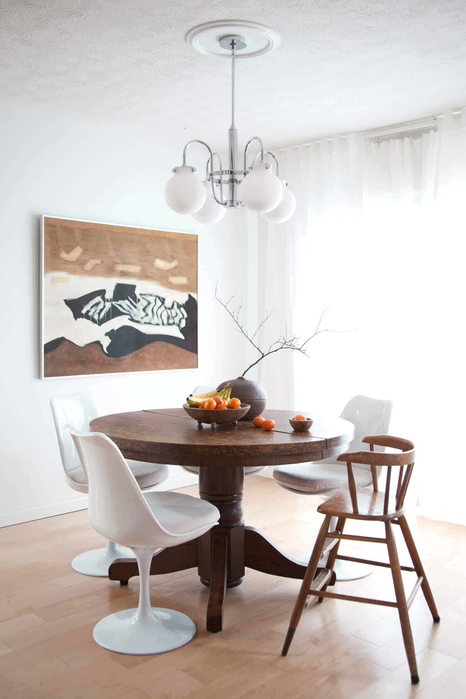 Antique pedestal table with modern tulip chairs