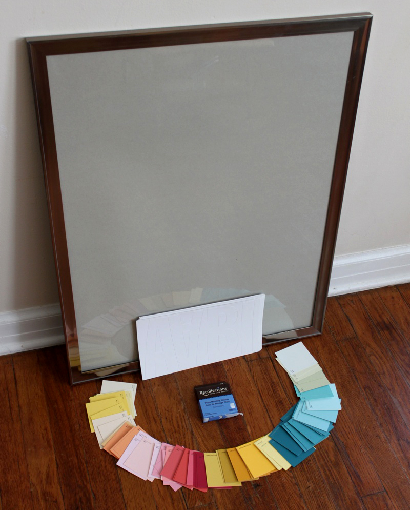Supplies needed large frame with paper insert a ton of pretty paint chips double sided tape squares and vinyl letters appropriate to the size of your