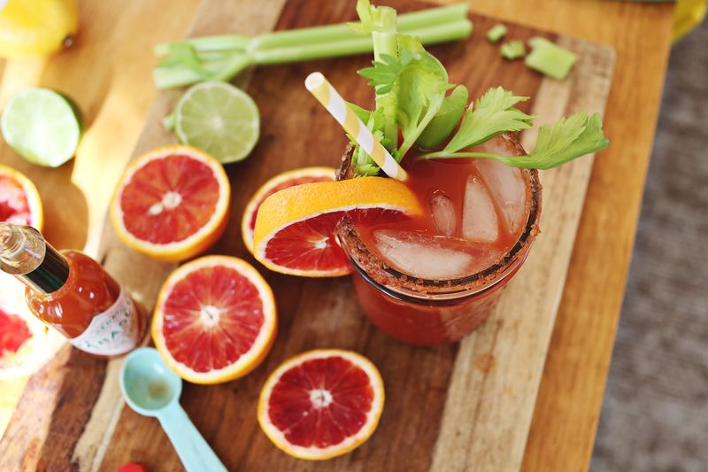 Mixing a blood orange bloody mary