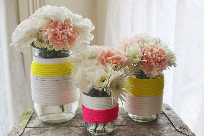 Jars wrapped in parachute cord for cute vases!