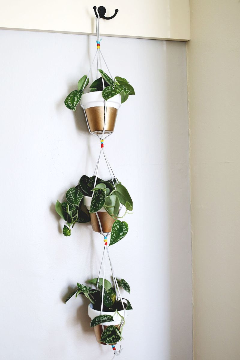 Gold Dipped Hanging Planters - A Beautiful Mess on diy indoor lighting, diy indoor ponds, diy gardening, unique planters, diy planter bench plans, diy indoor stairs, diy indoor furniture, diy planter ideas, diy self-watering planter, diy planter boxes, diy indoor signs, diy mason jar planter, diy indoor hammocks, diy indoor wall art, diy indoor water features, diy indoor shelves, diy indoor fences, diy indoor columns, diy wall decor, diy indoor benches,