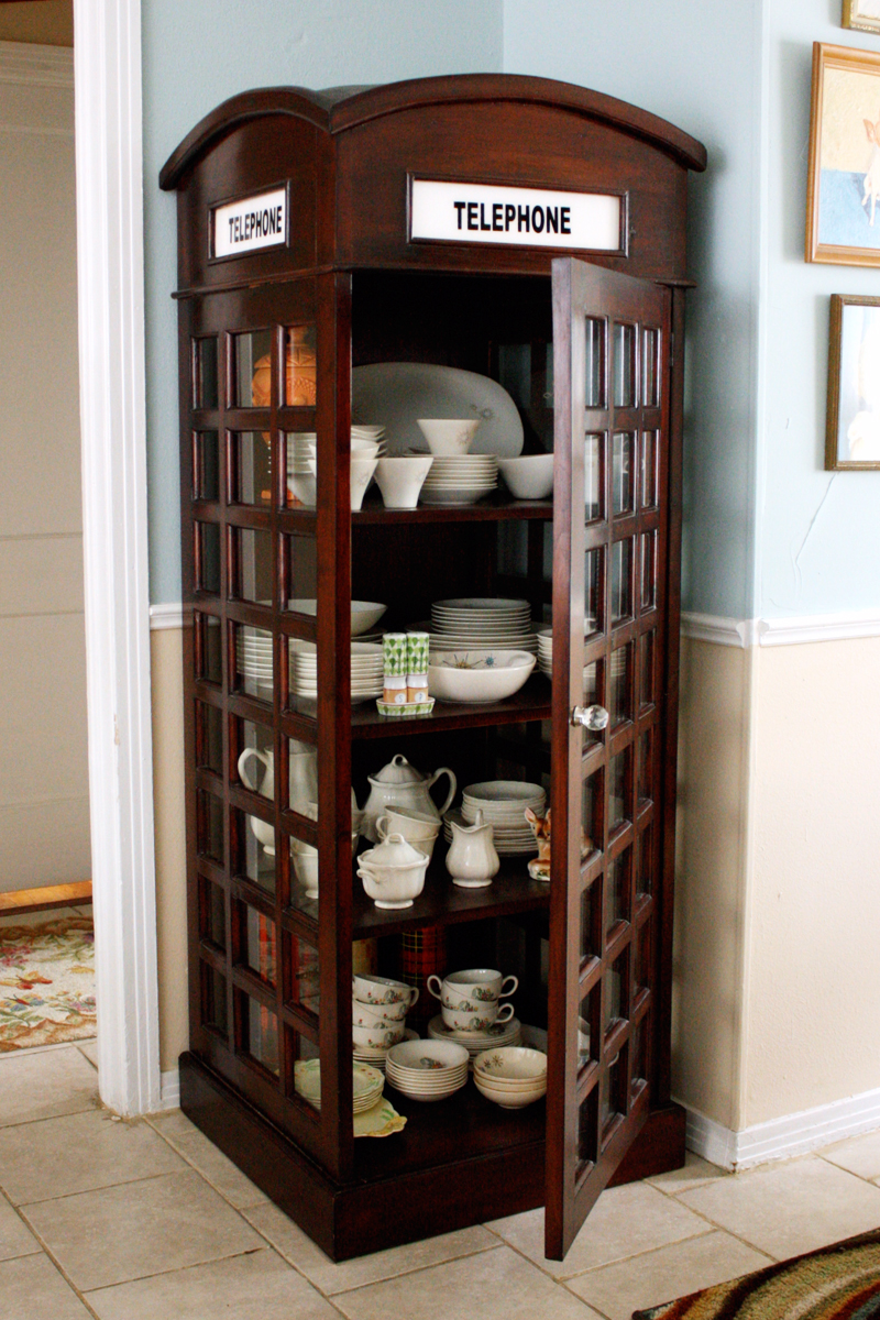 Telephone booth turned china cabinet-- need!