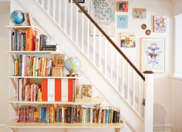 Bookshelves beneath stairs