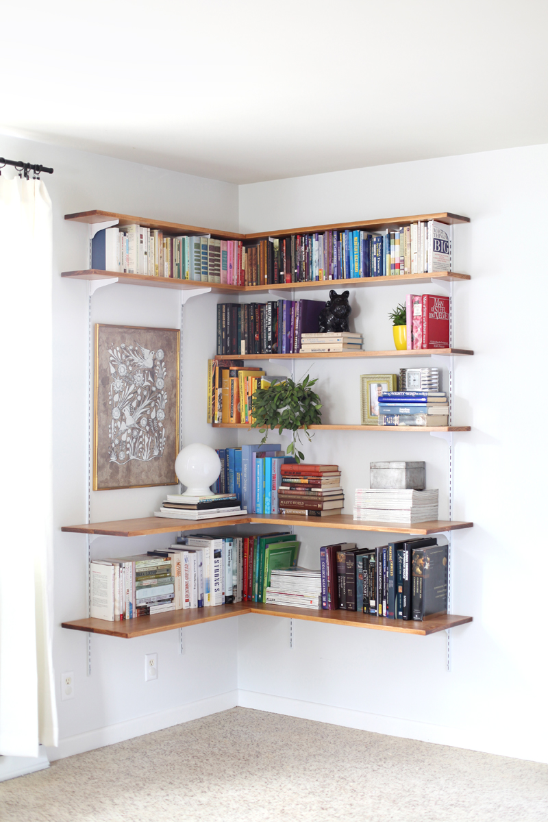 It's pretty simple to build your own shelving system. Click through for instructions and styling tips!