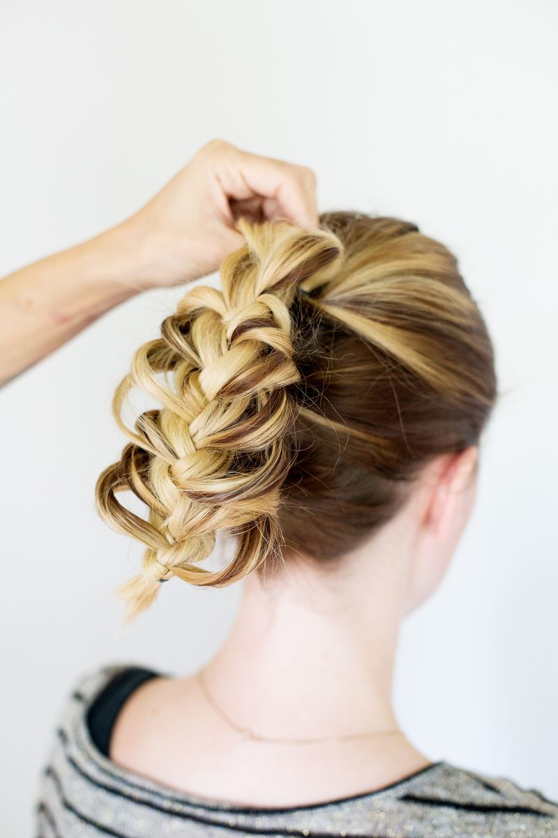 Step 7- take the top of the braid over the top hair elastic and pin into place with a bobbi pin