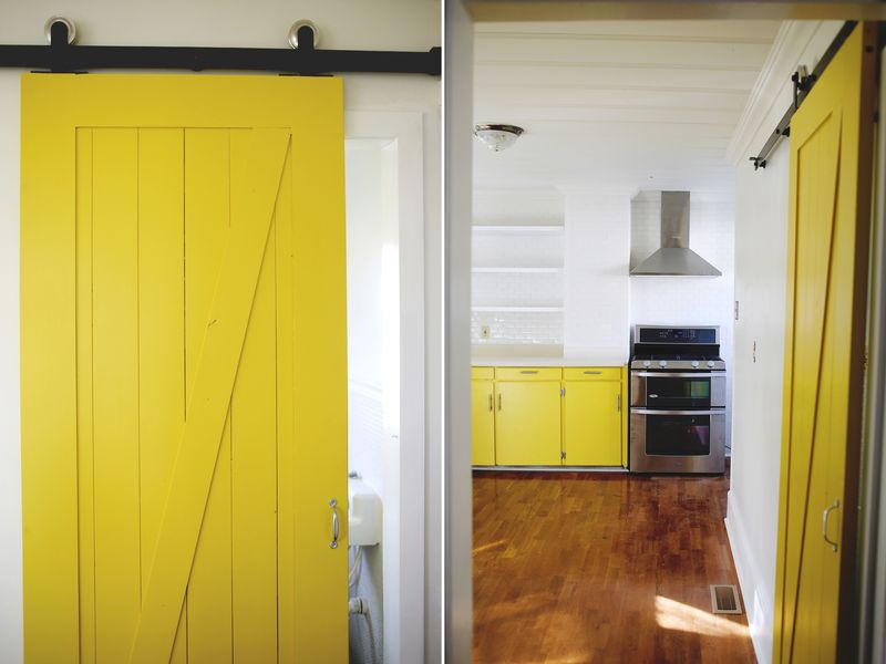 Yellow barn door in a kitchen