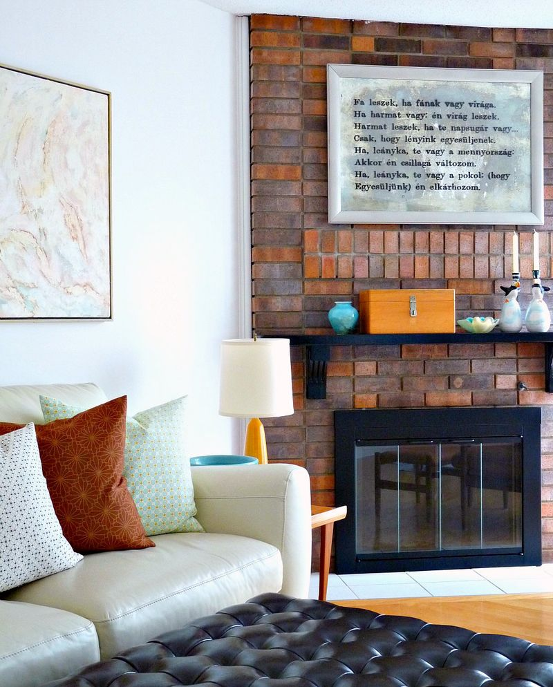 Love the stenciled mirror above the mantle