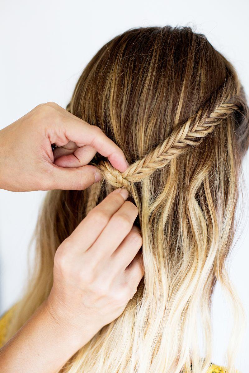 Tie hair in a knot again and remove hair elastics