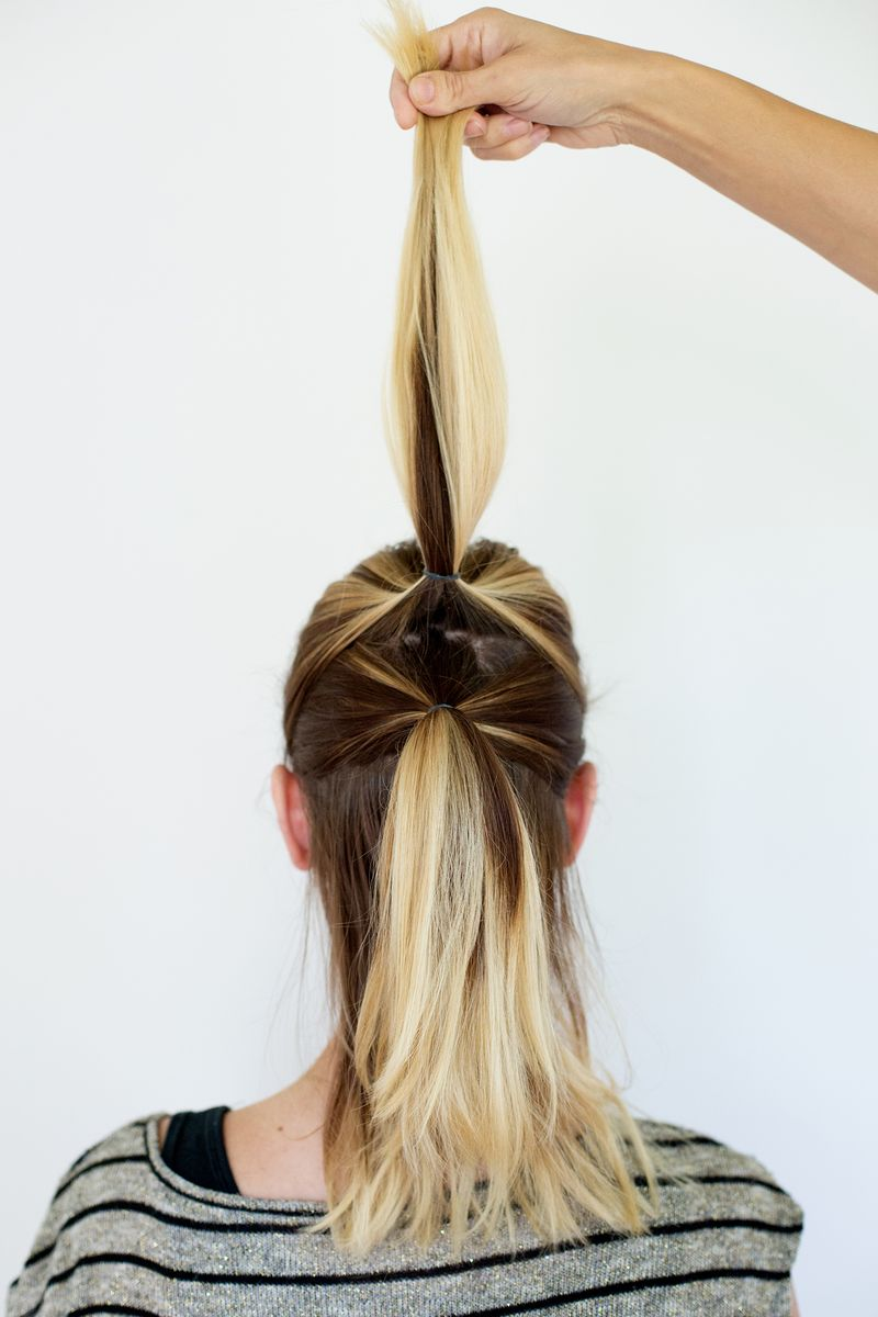 Step 2- Section the middle off and create another ponytail