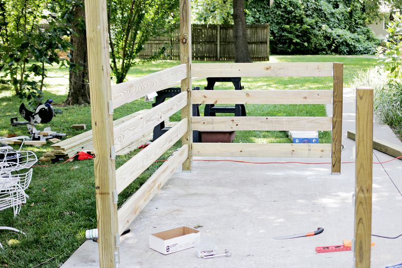 Build a pergola - installed beams (click through for more info)
