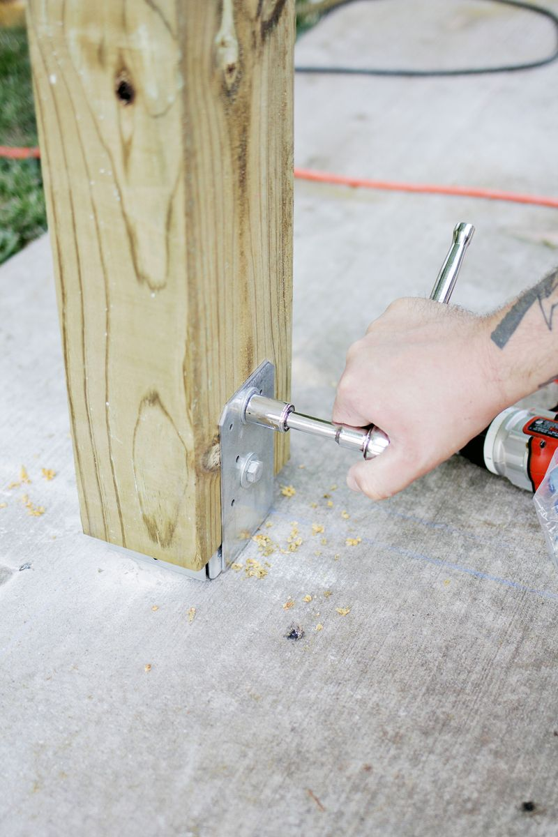 Build a pergola - bolting in vertical beam (click through for more info)
