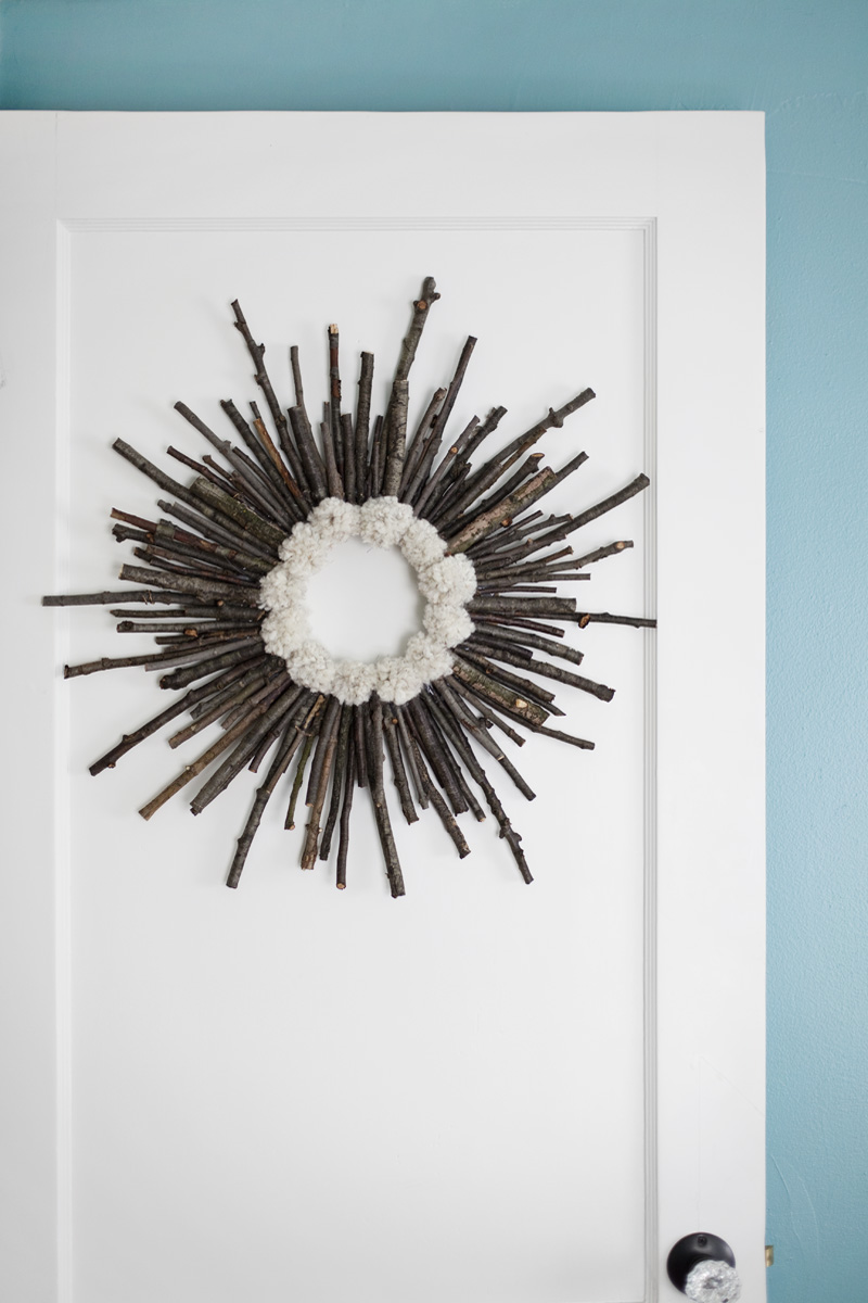 Make a twig and pom pom starburst wreath— It's practically free!