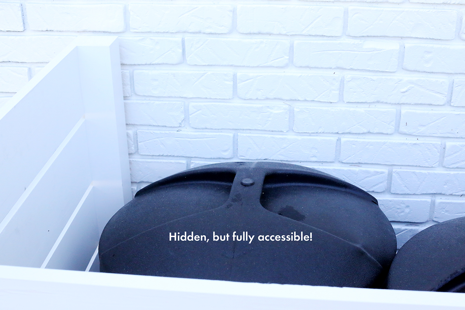 Try this- a modern solution for hiding your trash can