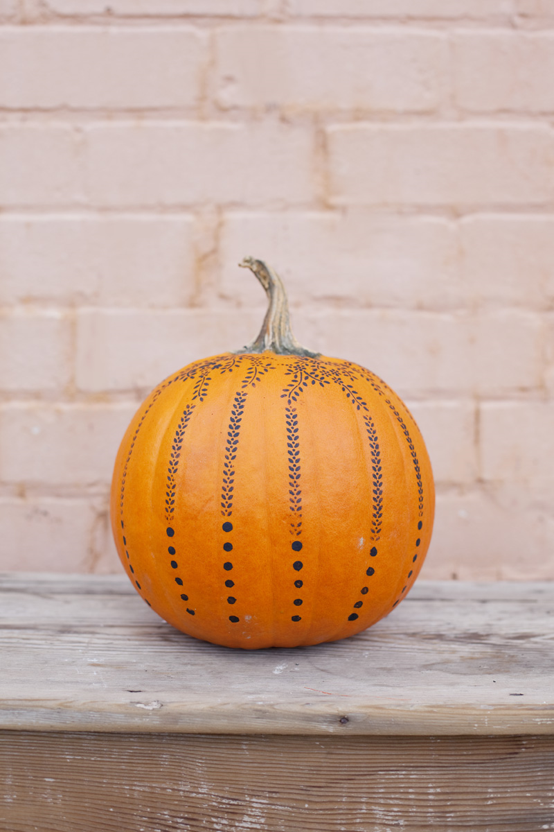 stencil-painted pumpkin