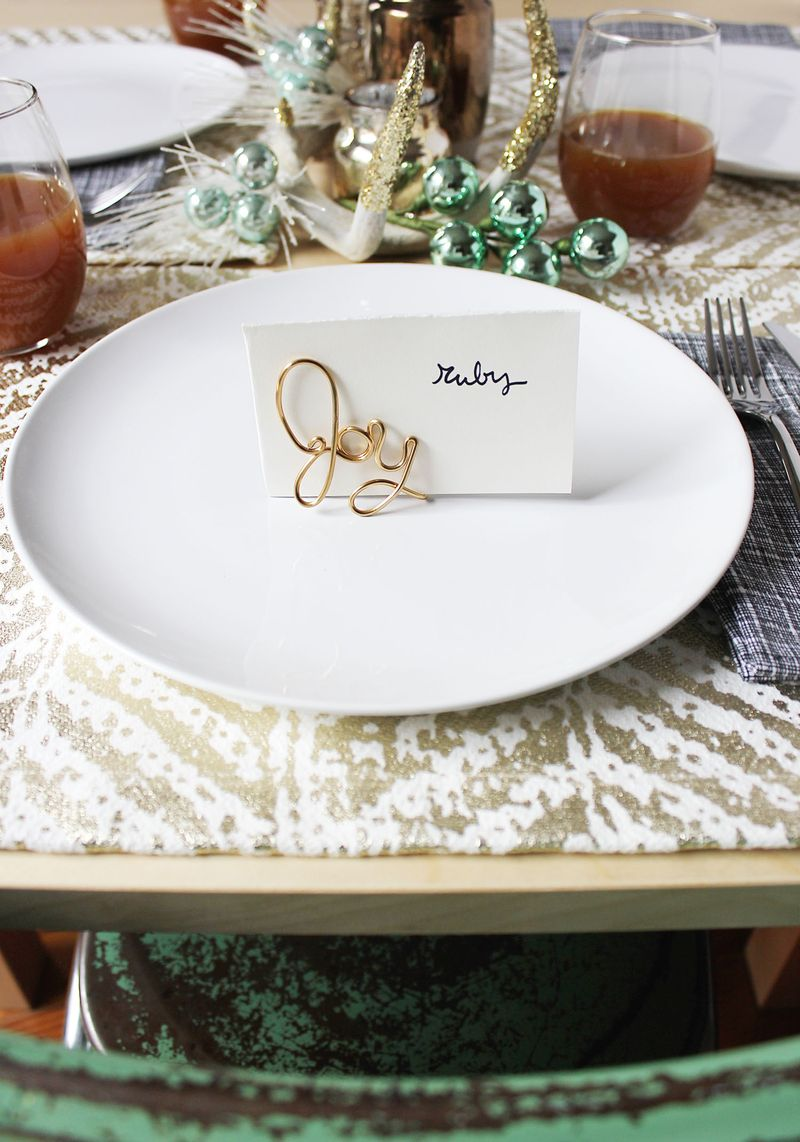 Try these easy wire placecard holders for your next holiday gathering. Get the tutorial on www.ABeautifulMess.com today