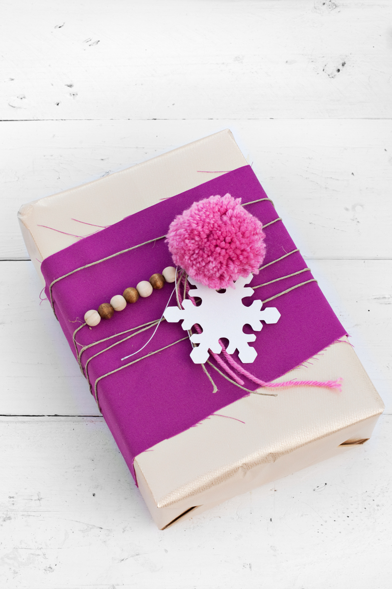 Use leftover beads and twine to add whimsy to your gift wrapping.