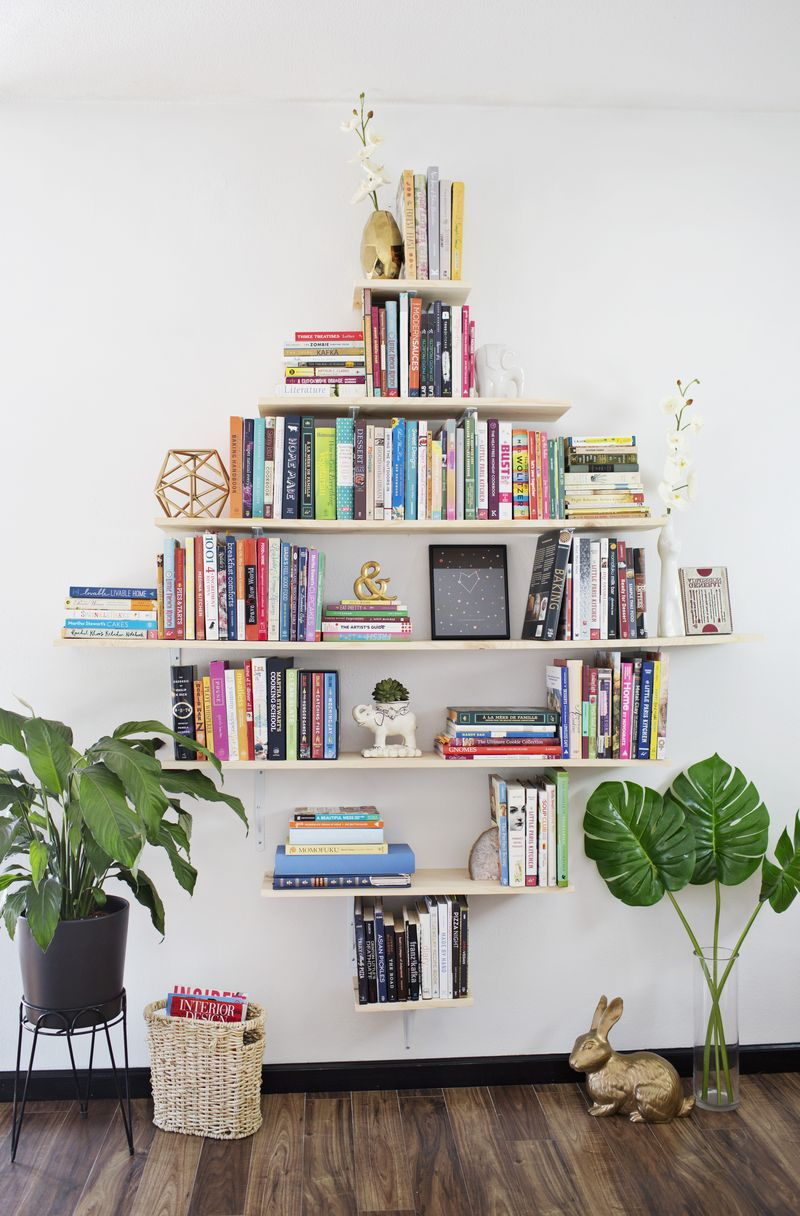 DIY Diamond Shaped Book Shelves (via abeautifulmess.com)