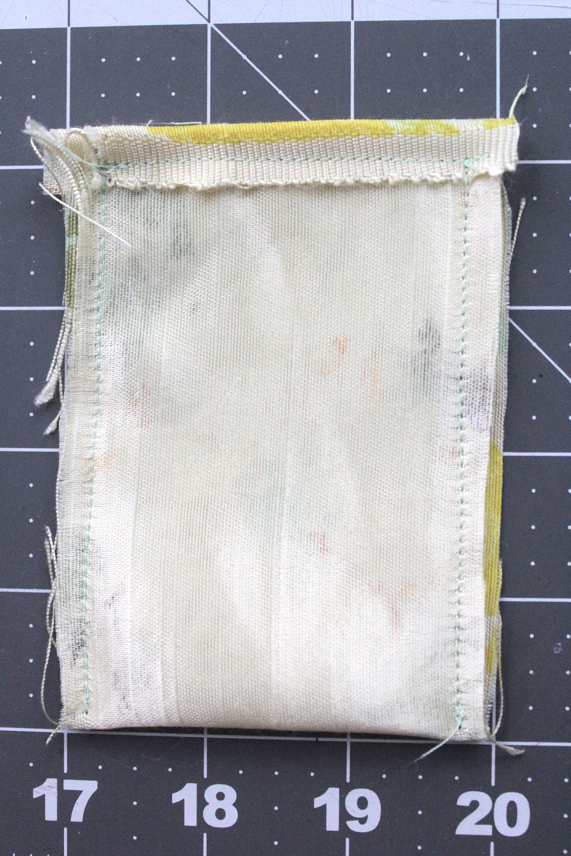 Step 8- fold the fabric in half and stitch sides