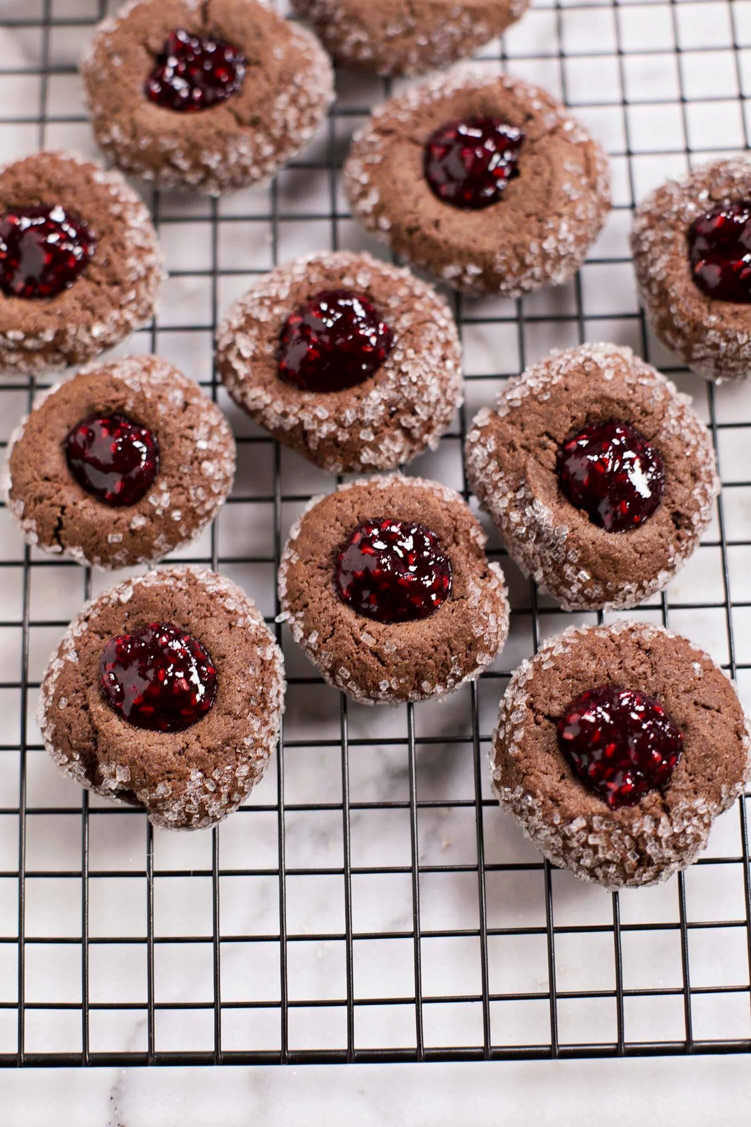 Chocolate thumbprint cookies with red wine raspberry jam (via abeautifulmess.com)