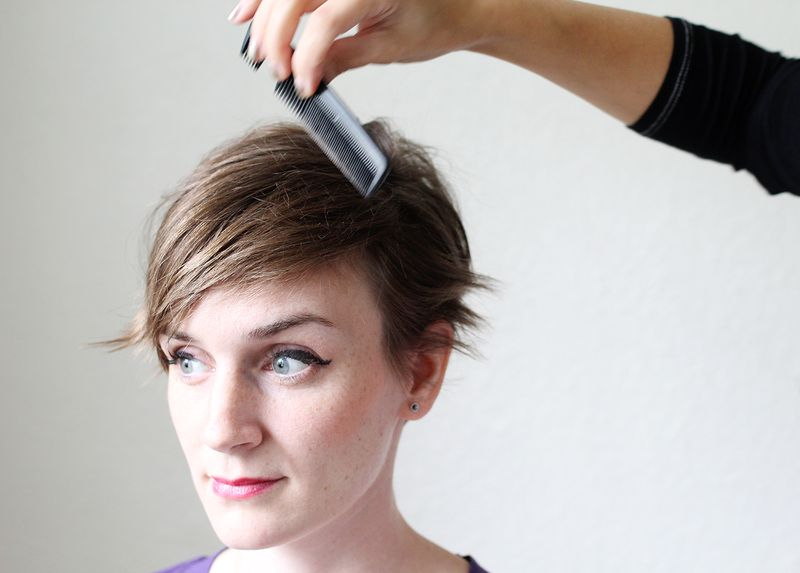 Comb hair over to create a deep part