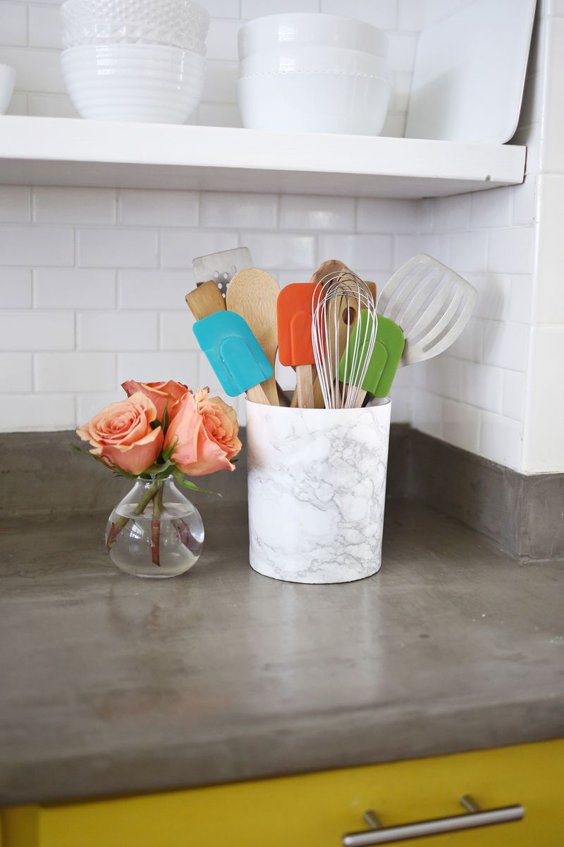 Try this! Recover your utensil holder with marble contact paper for a inexpensive marble look