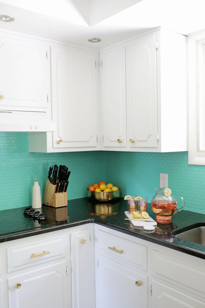 How to Paint a Tile Backsplash! - A Beautiful Mess Ideas For Kitchens Tile Paint on countertops for kitchens, fabric for kitchens, interior paint for kitchens, decorating idea for kitchens, gloss paint for kitchens, painting for kitchens, paint colors for kitchens,